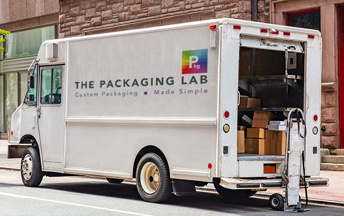 The Packaging Lab delivery truck parked on the road