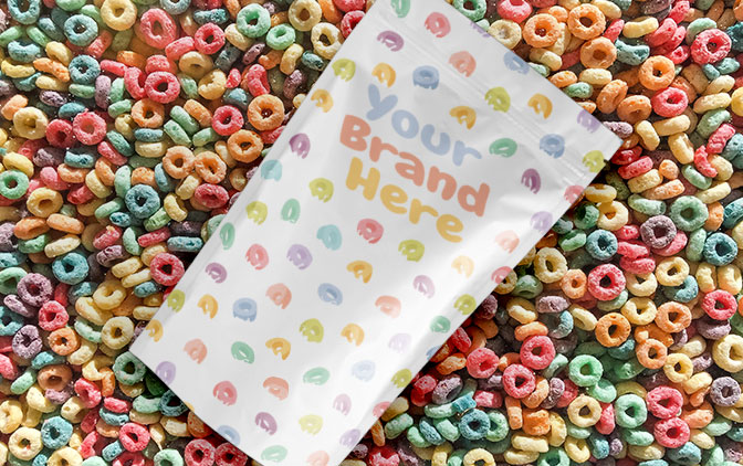 Custom printed pouch laying on colourful round cereals. The Packaging Lab offers custom packaging printing to the cereal industry